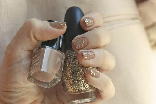nude nail polish with gold glitter top coat