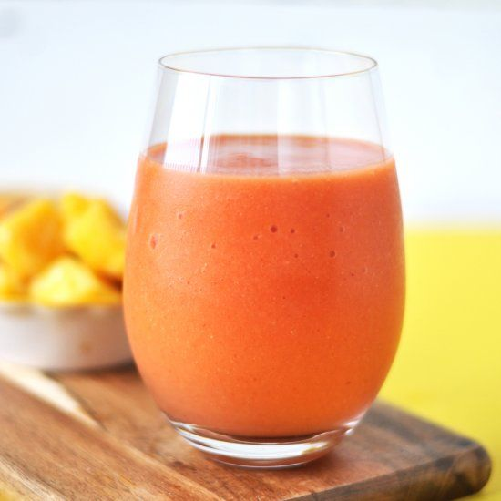 Start your morning with this healthy + refreshing Strawberry Mango Smoothie with orange and ginger.