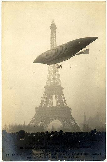 The airship Le Jaune by the LeBaudy brothers glides by the Eiffel Tower in 1903