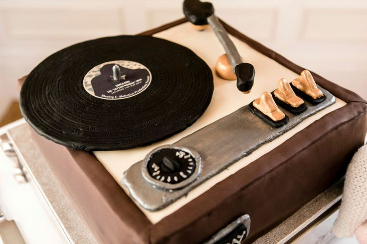 Vintage record player wedding cake | British 60s Rock Wedding Infused With 70's Music & Leopard Print Details | Photograph by Charlene Morton Photography   http://storyboardwedding.com/british-60s-rock-wedding-70s-music-leopard-print-details/