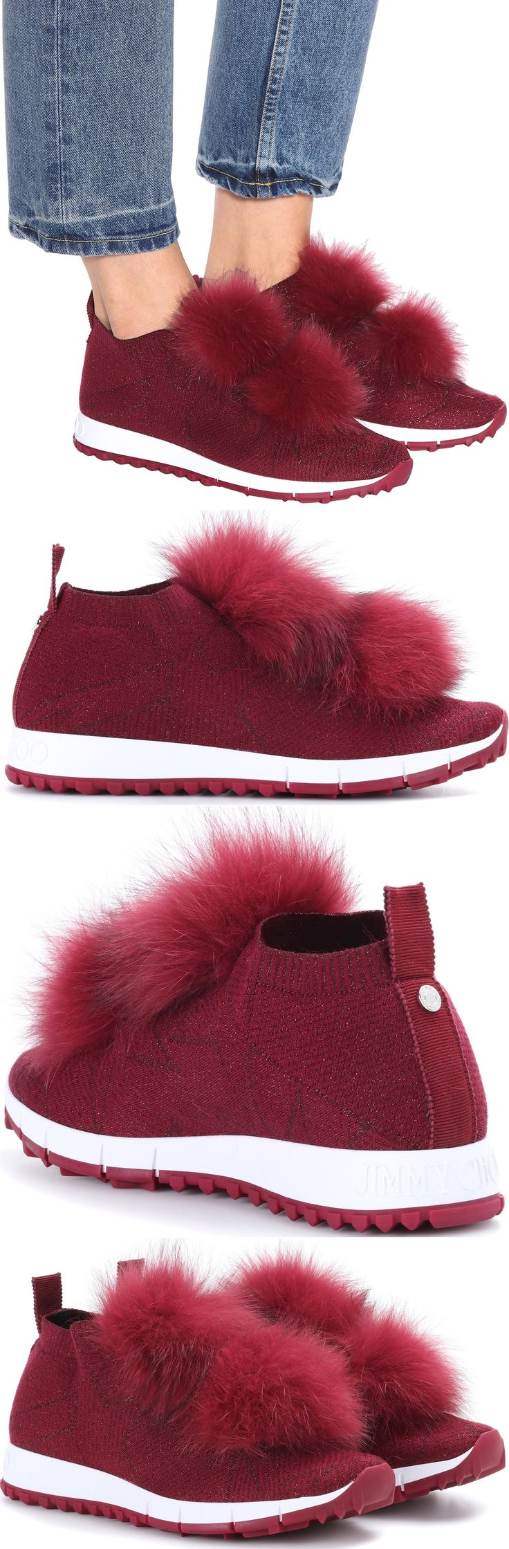 Offered here in a shimmering burgundy-red hue, Jimmy Choo's Norway sneakers are crafted from stretch fabric that provides a sock-like fit – a key look this season. Voluminous fur pompoms and metallic threading add flamboyant character, while the chunky rubber sole keeps the pair sportive.