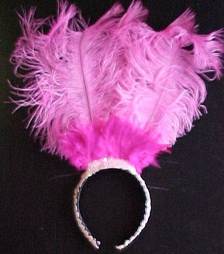 $20 on this website - but I SO could make it myself for about $5.00.  UGH. http://www.masks-wigs-and-costumes.com/Hats/images/pink_flamingo_headpiece.JPG