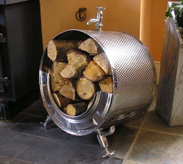 Log Store Made from washing machine drum with taps as legs and handle on the top