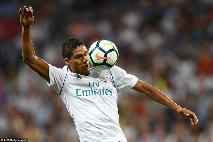 Madrid defenderRaphael Varane controls the ball but is more of a spectator as Madrid continue dominating the chances