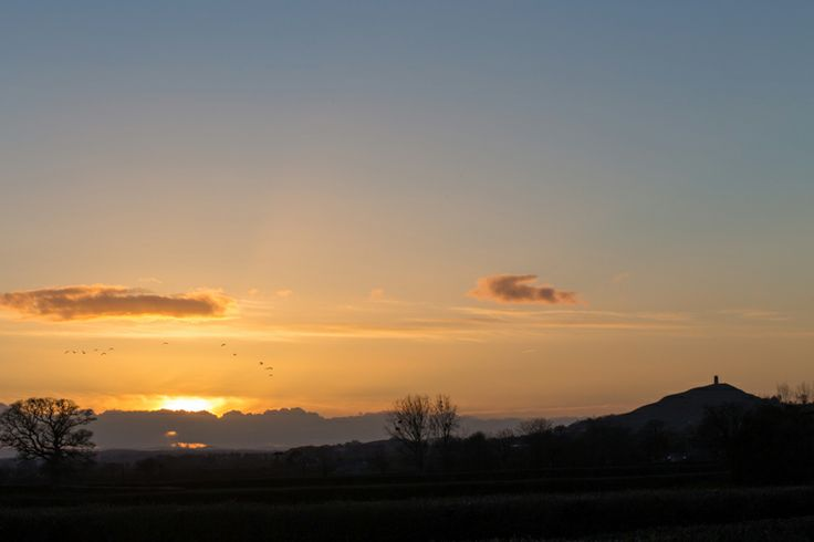 View of Glastonbury Tor & gorgeous sunset from Swallow's Orchard