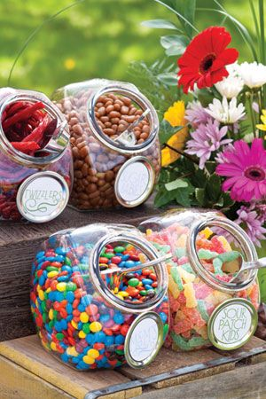 Attach sticker labels to Mason Jar lids to create tags for candy jars.