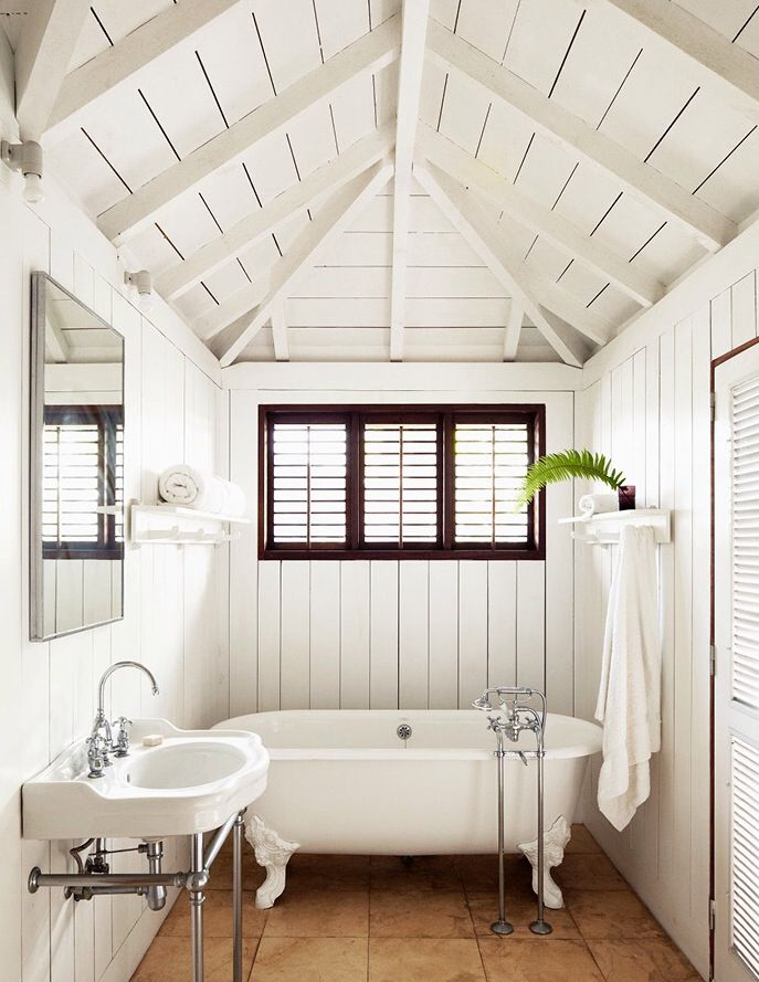 all white bathroom // vintage clawfoot bathtub