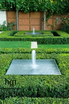 Beautiful hedges edging a very plain square fountain basin.  It's the hedge surround that lifts the fountain from ho hum to sophisticated.