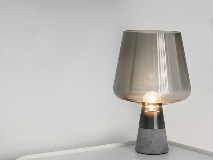 Iittala's striking table lamp Leimu that masterfully combines glass and concrete together is now available in an elegant grey. The combination of the grey glass 'shade' and the concrete base creates a streamlined design that emphasises the beauty of both materials. Designed by Magnus Pettersen.