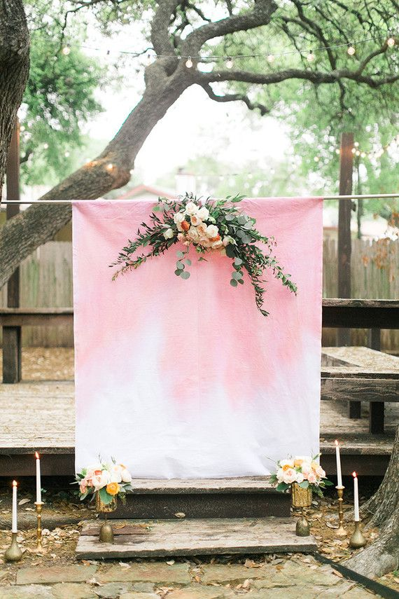 Ceremony backdrop with white and pink dip dyed fabric