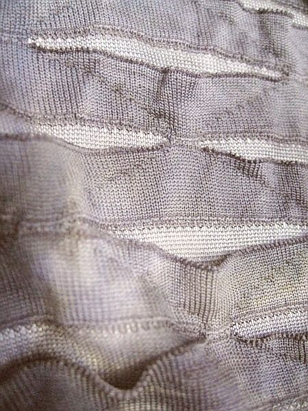 Contemporary knit sample with geometric pockets for tone & texture; knitwear; textiles for fashion