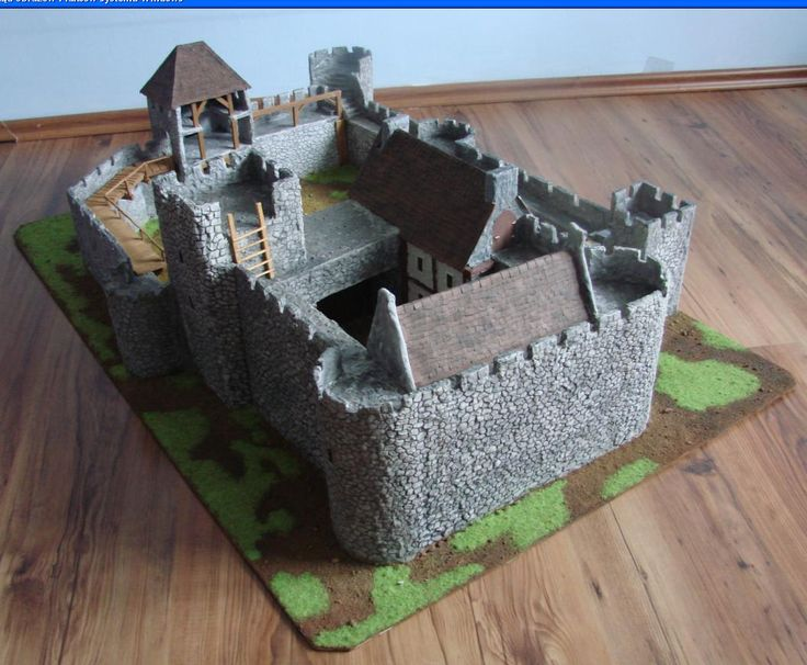 The album presents a model of a medieval castle, entirely designed and made by me. Made of cardboard, plaster and wood. Dimensions 100cm x 70cm base. Castle designed for strategic battle games on scale 28mm like Lord of the Rings SBG or Warhammer Bretonnia.