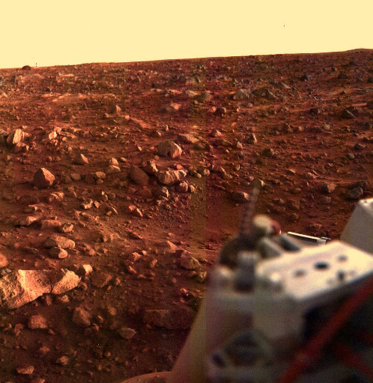 Color image of rocky Martian surface with portion of Viking Lander in lower right corner.  Amazing!  Read more about it at:  http://www.nasa.gov/image-feature/sunset-at-the-viking-lander-1-site