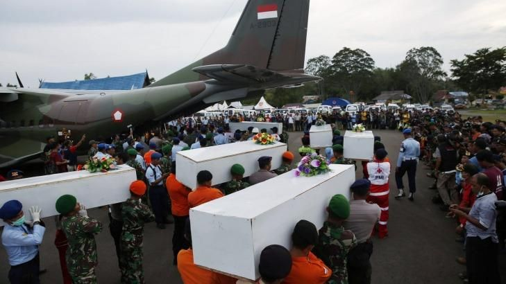 Bodies recovered from the sea are carried to a military transport plane to be taken to Surabaya. - Reuters