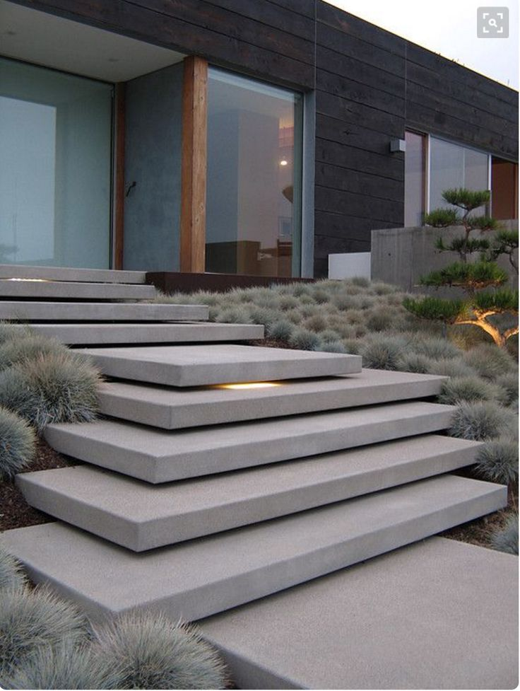Floating steps with gently graded garden bed to front entry
