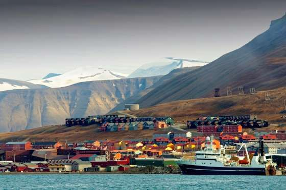 LONGYEARBYEN, NORWAY  The Scandinavian town of Longyearbyen is so far north that it's closer to the North Pole than it is to Oslo, Norway's capital. The arctic location makes for chilly temperatures year-round and long winters of unbroken darkness. The houses there are built on stilts in order to keep the underlying permafrost from melting beneath them and becoming unstable.