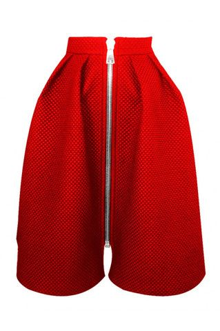 Red flared skirt with a front zipper. This design will look flattering on all frames. Tuck in your sweater to emphasize the high waist.