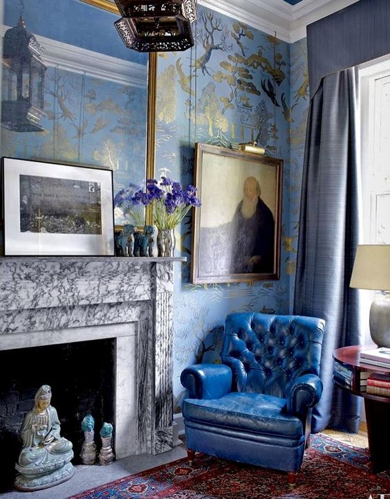 Richard McGeehan A fascinating mix in this room with stunning blue and gold wallpaper.
