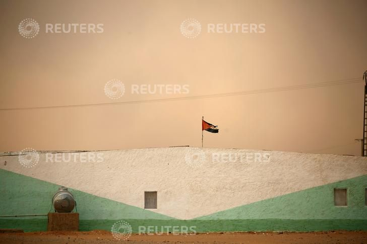 A Sahrawi Arab Democratic Republic flag flies at an indigenous Sahrawi refugee camp of Boudjdour, during a sand storm in Tindouf, southern Algeria. REUTERS/Zohra Bensemra