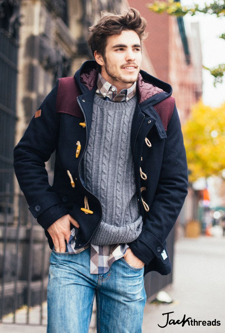Make a black duffel coat and blue jeans your outfit choice if you're going for a neat, stylish look. Shop this look for $132: http://lookastic.com/men/looks/brown-long-sleeve-shirt-grey-cable-sweater-black-duffle-coat-blue-jeans/7476 — Brown Gingham Long Sleeve Shirt — Grey Cable Sweater — Black Duffle Coat — Blue Jeans