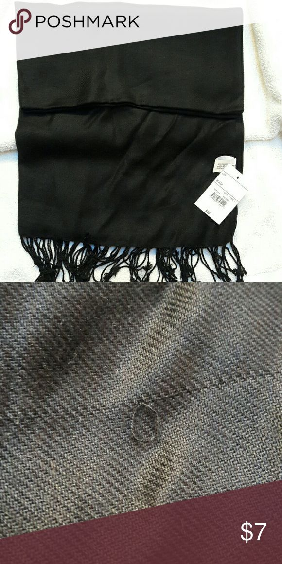 Black scarf with tassles 100 percent rayon scarf with black tassles. As you can see it still has tags, but there is a slight imperfection in it. I didn't notice when I purchased it. Christopher & Banks Accessories Scarves & Wraps
