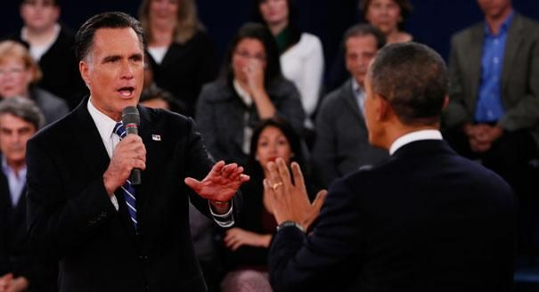 334 Slideshow: Scenes from the Hofstra debate. Large. Caption: Mitt Romney, left, addresses President Barack Obama  during the second presidential debate at Hofstra University. 10/16/12