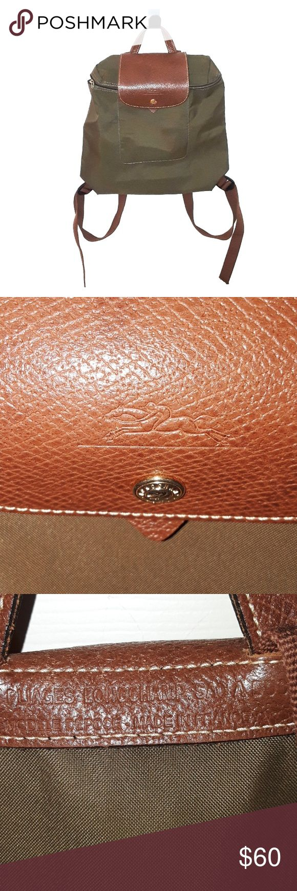 Authentic Les Pliages Longchamp Sac A Dos Backpack Older style authentic Les Pliages Longchamp Sac A Dos Modele Depose Backpack made in France. Used condition with spots on the outside and inside is also  used condition  as well. Picture four shows that the actual Longchamp small piece is missing on  the backpack but you are still able to zip it up . Very nice quality as this is the vintage style backpack made in France, beautiful  color, lightweight used condition,wear on Corners…