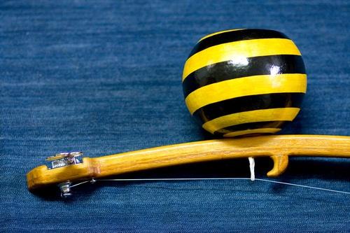 yellow and black cabasa