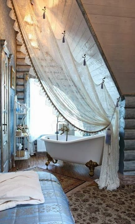 Create an illusion of an intimate bath space in a large bathroom - add a unique curtain *for those hard to decorate upstairs walls ... #Design #Bathrooms #Interior