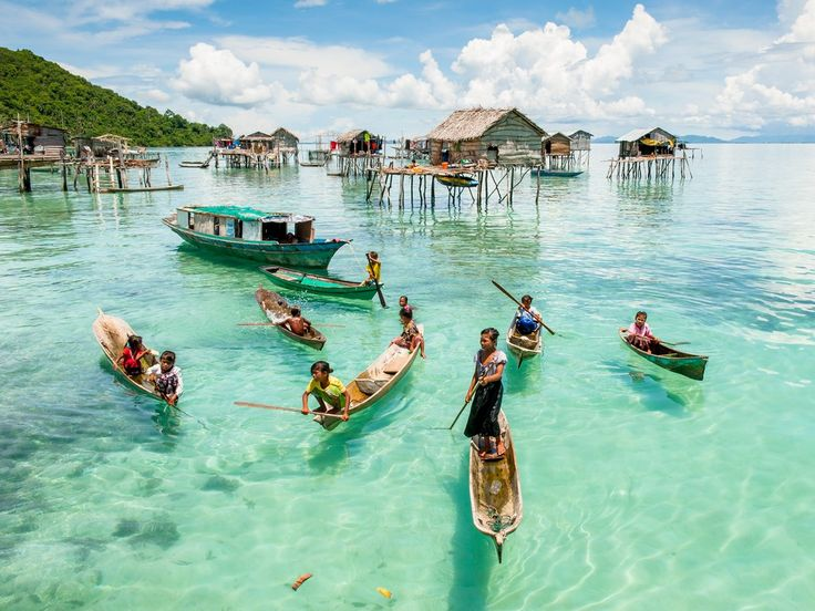 """A jumping off point for diving trips to surrounding islands, the beautiful town of Semporna offers a nice glimpse of local life. Many people here live in """"water villages,"""" large groups of houses built on stilts that can be viewed by boat."""