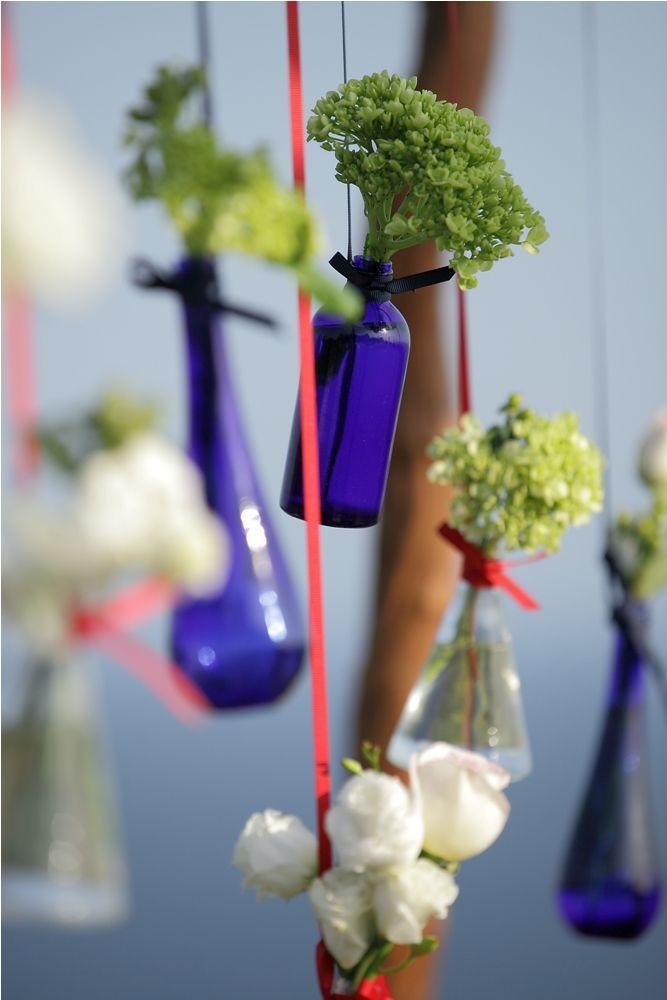 Bottled flowers adorning the Canopy by Tirtha Bridal Uluwatu Bali