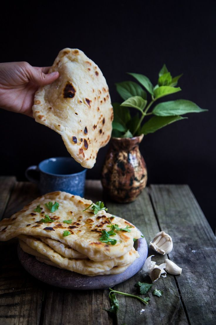 Homemade garlic naan. So soft and stretchy you can't stop tearing and munching these guys!