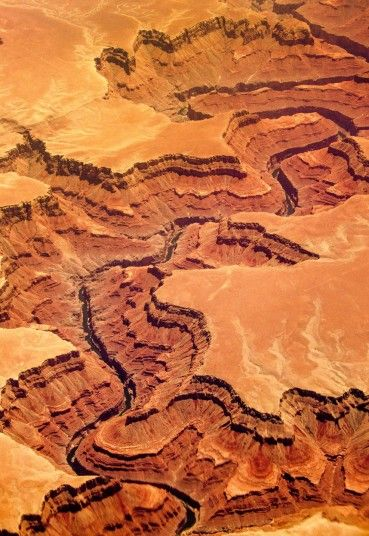 An aerial picture of the Grand Canyon. The Grand Canyon, considered one of the seven natural wonders of the world, is 277 miles (446 km) long, up to 18 miles (29 km) wide