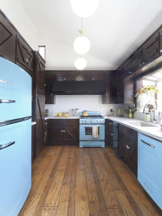 Beach Blue Big Chill kitchen for Celebrity Jeannie Mai on HGTV's Kitchen Cousins. The blue really accentuates the kitchens wooden features. Find out how you can get the look today.