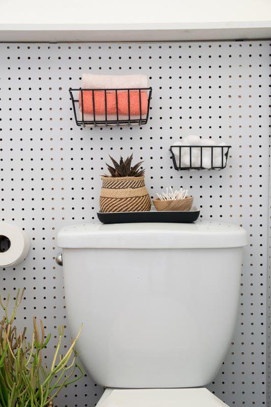 A fresh new look for a formerly sad rental bathroom.