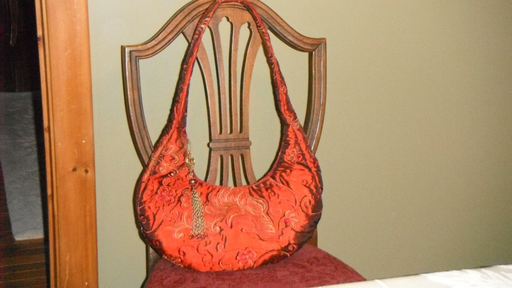 Hobo style bag in quilted and embroidered satin.