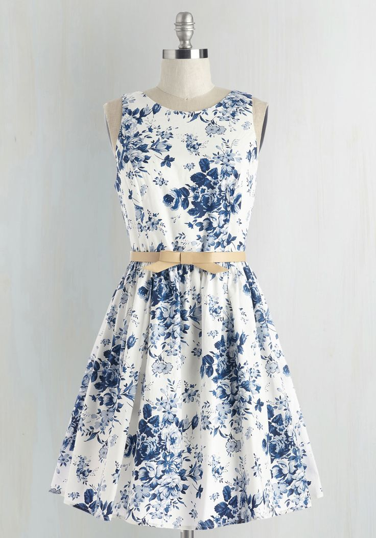 When you take your peppy panache to the southern coast in this white floral dress, you're welcomed by the warm breeze and even warmer smiles. This retro A-line is detailed with a blue delft-inpsired print and a cute back cutout, all of which adds a 'sun' of cheer to your bright days.