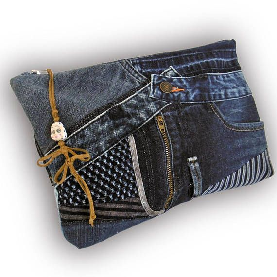 One-of-a-kind. Convenient and stylish. Pretty cool recycled jean patchwork clutch bag. A bag is made from old Jeans and vintage splashed pattern hand-dyed Indigo fabric. Fully lined with pockets: 3 x inside, 2 x outside. Zipper top closure. The bag can be held by placing the thumb in a loop.