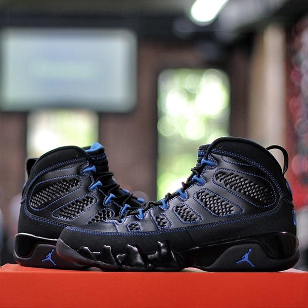 black jordans with blue bottom