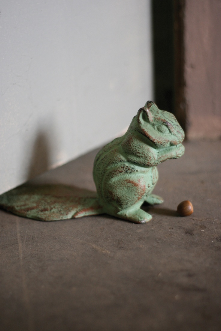 cast iron chipmunk antique green This cast iron chipmunk is the perfect door stop! Let this adorable cast iron critter greet you every time you pass through the doorway!