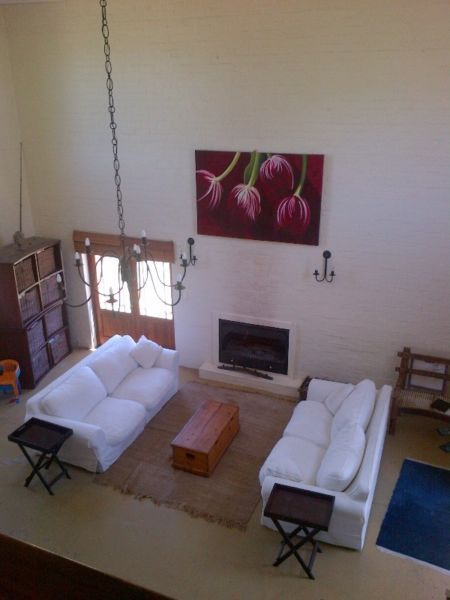 Large double volume open plan lounge dining room and kitchen Two berooms both en-suite one double and double bunk Main bedroom en-suite upstairs with small balcony.Fully equipped washing, machine, dishwasher, DSTVGarden fully walled in. Accommodates 6 persons