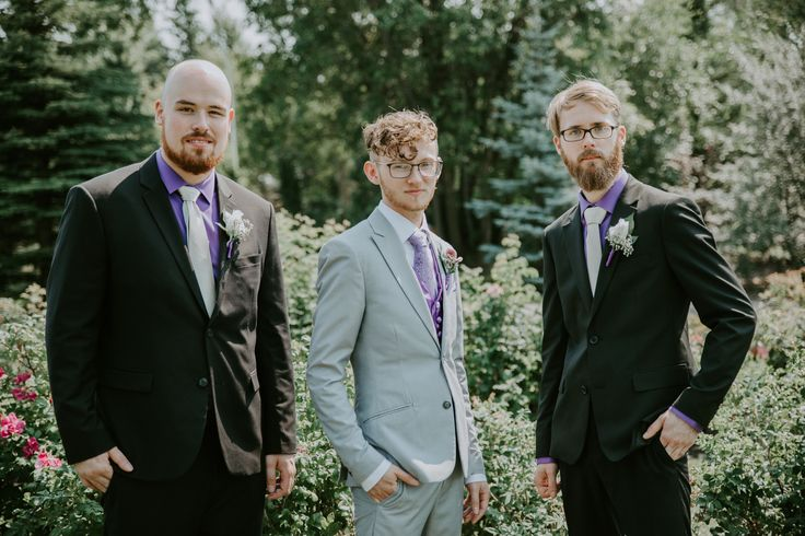 Black and purple groomsmen attire.
