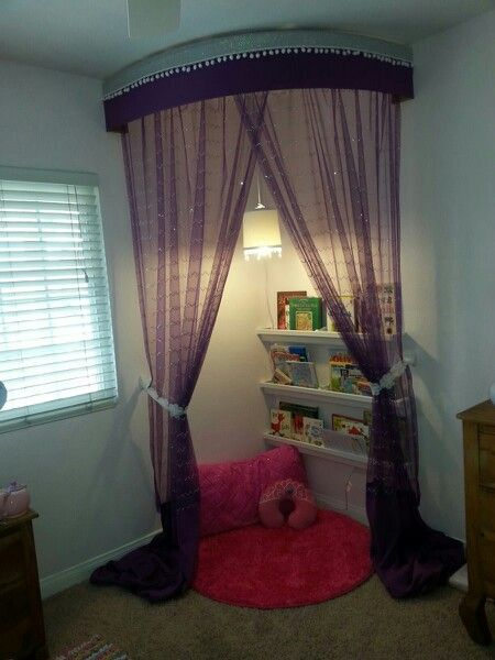 DIY Success! Made a little girl's reading nook with walmart curtains, sheers, plastic rain gutters (for book shevles) and a crystal bedazzled pendant lamp.  Love how it all came together.