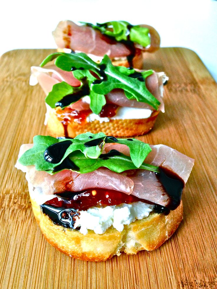 Prosciutto, Goat Cheese & Fig Jam Crostini with Arugula & Balsamic Reduction
