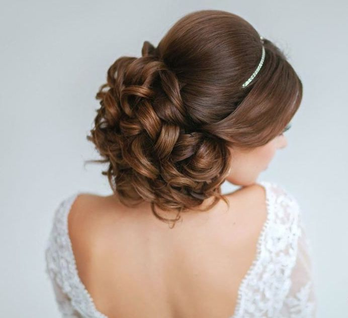 Classy and Elegant Wedding Hairstyles | Curled hair bun | Bridal up do