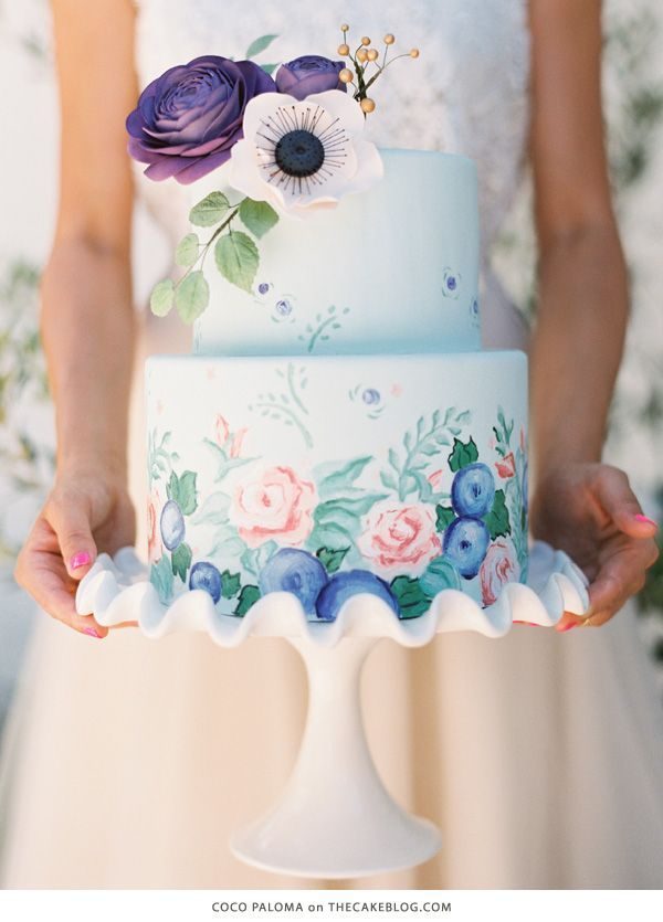 I love this spring wedding cake using pastels and floral detail.