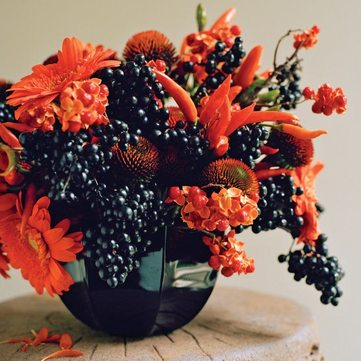 A Fall Flower Arrangement That Echoes The Colors Of Halloween.