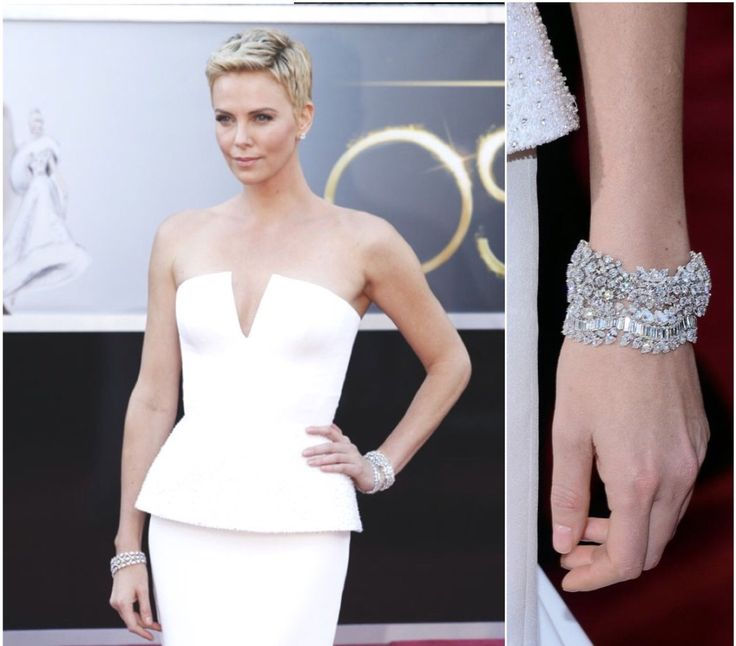 Charlize Theron wore Harry Winston diamond jewels to the 2013 Oscars worth a total of $4.5 million. #oscars #oscarjewelry #oscarfashion