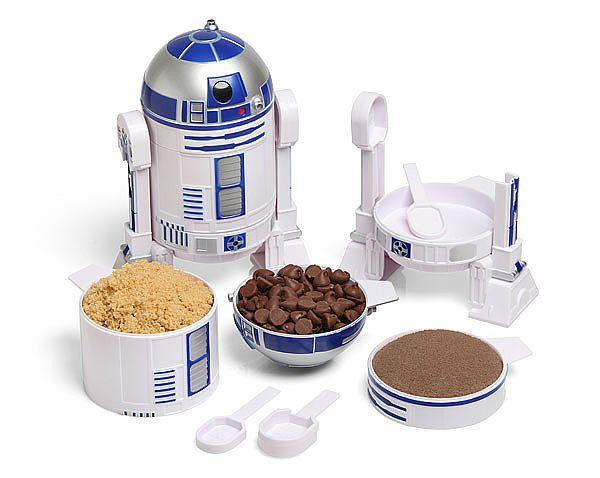 """""""Every year, I buy several of my holiday gifts from ThinkGeek! I am personally obsessing over this R2-D2 measuring cup set ($20)! I love to bake, and this little guy looks so cute in my kitchen!"""""""