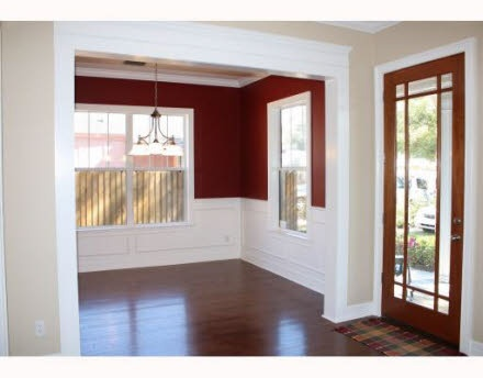 Red might be a bit too bold for us.  Paint the molding white or leave it brown?